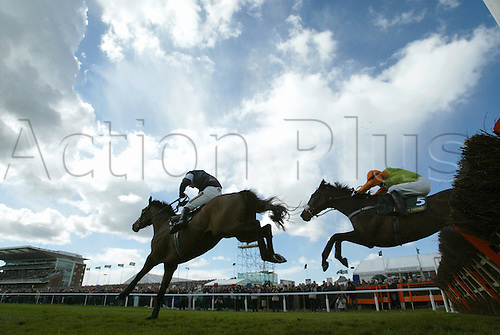 8 April 2005: Jockey Richard Johnson on Mighty Man jump the last fence on their way to victory ahead of Tony McCoy on Dusky Warbler during the John Smith's Top Novices' Hurdle Race held at Aintree Racecourse, Liverpool. Photo: Neil Tingle/Action Plus..050408 horse racing national hunt equestrian sports hurdling remote