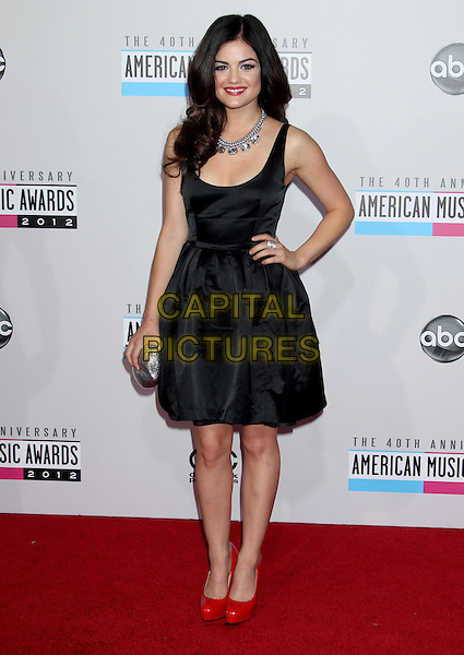 Lucy Hale.40th Anniversary American Music Awards - Arrivals held at Nokia Theatre L.A. Live, Los Angeles, California, USA..November 18th, 2012.AMA AMAs full length dress sleeveless black red shoes silver clutch bag necklace hand on hip.CAP/ADM/RE.©Russ Elliot/AdMedia/Capital Pictures.