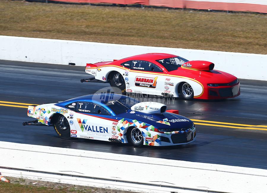 Mar 18, 2017; Gainesville , FL, USA; NHRA pro mod driver Rickie Smith (near) races alongside Khalid Albalooshi during qualifying for the Gatornationals at Gainesville Raceway. Mandatory Credit: Mark J. Rebilas-USA TODAY Sports
