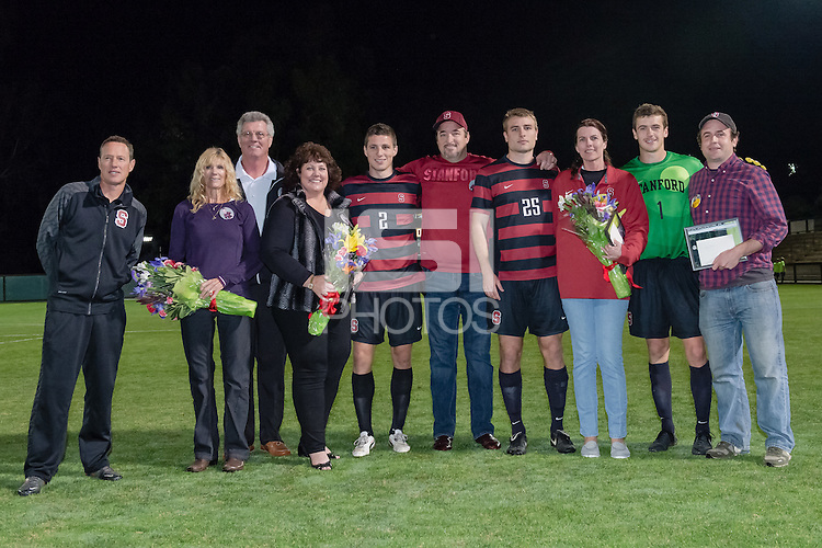 November 13, 2013: JJ Koval, Tyler Conklin and Drew Hutchins their families during the senior day ceremony before the Stanford vs Cal men's soccer match in Stanford, California.  Stanford won 2-1 in overtime.