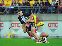 Leigh Montagna is tackled during the ANZAC Day AFL match between St Kilda Saints and Brisbane Lions at Westpac Stadium, Wellington, New Zealand on Friday, 25 April 2014. Photo: Dave Lintott / lintottphoto.co.nz