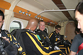 Former President George H.W. Bush talks with members of the United States Army Golden Knights Parachute Team in the aircraft as they prepare to jump from 13,000 feet at the Bush Presidential Library near Houston, Texas on June 13, 2004 to celebrate his his 80th birthday.<br /> Credit: US Army via CNP