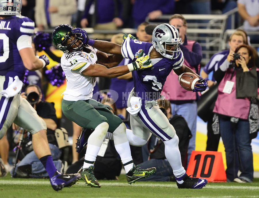 Jan. 3, 2013; Glendale, AZ, USA: Kansas State Wildcats wide receiver Chris Harper (3) stiff arms Oregon Ducks safety Brian Jackson (12) in the second quarter during the 2013 Fiesta Bowl at University of Phoenix Stadium. Mandatory Credit: Mark J. Rebilas-