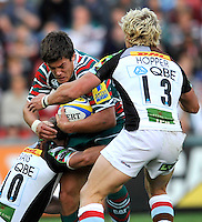 Leicester, England. Anthony Allen of Leicester Tigers tackled during the Aviva Premiership match between Leicester Tigers and Harlequins at Welford Road on September 22, 2012 in Leicester, England.