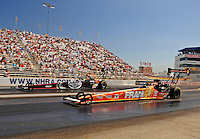 Sept. 5, 2010; Clermont, IN, USA; NHRA top fuel dragster driver Cory McClenathan (near) races alongside Larry Dixon during qualifying for the U.S. Nationals at O'Reilly Raceway Park at Indianapolis. Mandatory Credit: Mark J. Rebilas-
