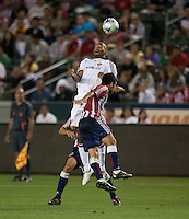 Tony Sanneh heads the ball over Paulo Nagamura. The LA Galaxy defeated Chivas USA 1-0 at Home Depot Center stadium in Carson, California Saturday evening July 11, 2009.