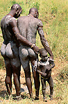 Surma tribesmen and child of the Lower Omo River, Ethiopia
