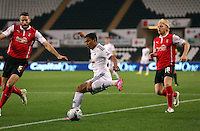 Pictured: Jefferson Montero of Swansea (C) against Kirk Broadfoot (L) and Ben Pringle of Rotherhamy (R). Tuesday 26 August 2014<br /> Re: Capital One Cup, Swansea City FC v Rotherham at the Liberty Stadium, south Wales