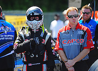May 6, 2012; Commerce, GA, USA: NHRA top fuel dragster driver Steve Torrence with crew member during the Southern Nationals at Atlanta Dragway. Mandatory Credit: Mark J. Rebilas-
