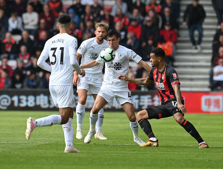 Burnley's Jack Cork (centre) vies for possession with Bournemouth's Joshua King (right) <br /> <br /> Photographer David Horton/CameraSport<br /> <br /> The Premier League - Bournemouth v Burnley - Saturday 6th April 2019 - Vitality Stadium - Bournemouth<br /> <br /> World Copyright © 2019 CameraSport. All rights reserved. 43 Linden Ave. Countesthorpe. Leicester. England. LE8 5PG - Tel: +44 (0) 116 277 4147 - admin@camerasport.com - www.camerasport.com