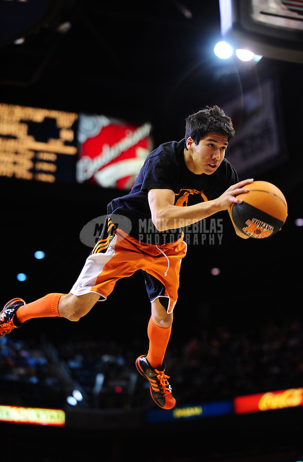 Jan. 26, 2011; Phoenix, AZ, USA; Phoenix Suns performer Nick Corrales flies through the air as he attempts to perform a dunk prior to the fourth quarter against the Charlotte Bobcats at the US Airways Center. The Bobcats defeated the Suns 114-107. Mandatory Credit: Mark J. Rebilas-