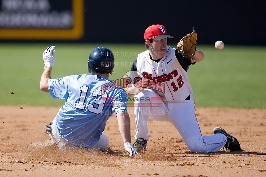 Dustin Ackley (13) of the North Carolina Tar Heels slides into second base as Jeff Grantham (12) of the St. John's Red Storm waits for the throw at the 2008 Coca-Cola Classic at the Winthrop Ballpark in Rock Hill, SC, Sunday, March 2, 2008.