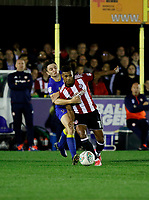 AFC Wimbledon's Anthony Hartigan gets to grips with Brentford's Ollie Watkins during the Carabao Cup match between AFC Wimbledon and Brentford at the Cherry Red Records Stadium, Kingston, England on 8 August 2017. Photo by Carlton Myrie.