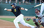 SIOUX FALLS, SD - JULY 2 A.J. Kirby-Jones #44 from the Sioux Falls Canaries rips a base hit against the Gary Southshore Railcats in the fourth inning Wednesday night at the Sioux Falls Stadium. (Photo by Dave Eggen/Inertia)
