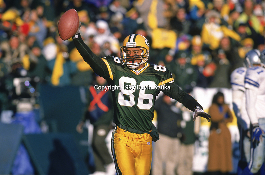 Green Bay Packers wide receiver Antonio Freeman (86) celebrates on the field during a game against the Dallas Cowboys at Lambeau Field on November 23, 1997 in Green Bay, Wisconsin.  The Packers won 45-17. (Photo by David Stluka)