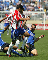 San Jose's Troy Dayak makes a slide tackle on Chivas USA's Arturo Torres during a 2005 MLS game between the San Jose Earthquakes and Chivas USA on April 9, 2005 at Spartan Stadium in San Jose, California.  The game ended in a 3-3 tie.  Credit: JN Santos/ISI