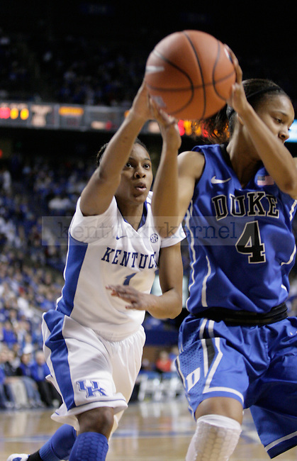 UK's A'dia Mathies tries to steal the ball from Duke's Chloe Wells at Rupp Arena on Thursday, Dec. 8, 2011. Photo by Scott Hannigan | Staff