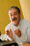 Hispanic man playing cards,  clapping, close-up