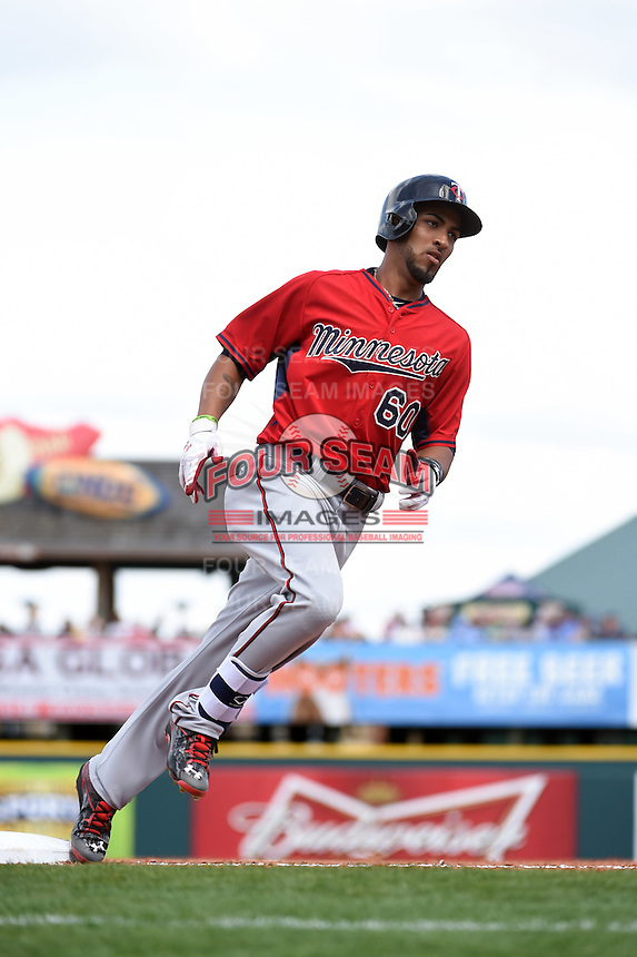 Minnesota Twins outfielder Eddie Rosario (60) runs the bases after hitting a home run during a Spring Training game against the Pittsburgh Pirates on March 13, 2015 at McKechnie Field in Bradenton, Florida.  Minnesota defeated Pittsburgh 8-3.  (Mike Janes/Four Seam Images)