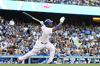 Yasiel Puig #66 of the Los Angeles Dodgers hits a home run against the San Francisco Giants at Dodger Stadium on June 25, 2013 in Los Angeles, California. (Larry Goren/Four Seam Images)