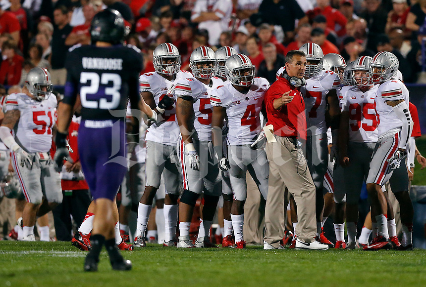 OSU coach Urban Meyer guides the team in the first  quarter of their game at Ryan Field in Evanston, IL on October 5, 2013. Columbus Dispatch photo by Brooke LaValley)