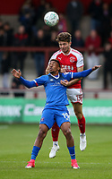 Fleetwood Town's Joe Maguire heads clear under pressure from Carlisle United's Reggie Lambe <br /> <br /> Photographer Andrew Kearns/CameraSport<br /> <br /> The Carabao Cup First Round - Fleetwood Town v Carlisle United Kingdom - Tuesday 8th August 2017 - Highbury Stadium - Fleetwood<br />  <br /> World Copyright &copy; 2017 CameraSport. All rights reserved. 43 Linden Ave. Countesthorpe. Leicester. England. LE8 5PG - Tel: +44 (0) 116 277 4147 - admin@camerasport.com - www.camerasport.com