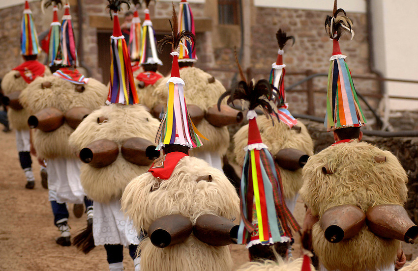 ITUREN, NAVARRE- JANUARY 30: A group of 'Zanpantzar', people dressed in sheep fur and big cowbells tied to their back, march across Ituren village during an ancient traditional carnival on January 30, 2006. Zanpantzar´s march trough Ituren farmhouses and streets sounding their cowbells to wake up the earth for a good new farmer year and keep far away all bad spirits . Photo by Ander Gillenea