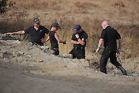Pictured: Detective Inspector Jon Cousins (R) joins forensic archaeologists at the second site in Kos, Greece. Wednesday 12 October 2016<br />