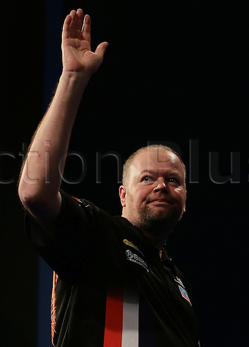 29.12.2015. Alexandra Palace, London, England. William Hill PDC World Darts Championship. Raymond van Barneveld waves to the crowd as he enters the stage