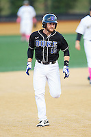 Mike Rosenfeld (15) of the Duke Blue Devils hustles towards third base against the Wake Forest Demon Deacons at Wake Forest Baseball Park on April 25, 2014 in Winston-Salem, North Carolina.  The Blue Devils defeated the Demon Deacons 5-2.  (Brian Westerholt/Four Seam Images)