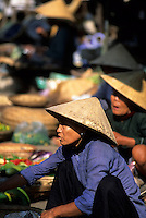 Woman selling vegetables in market, Hoi An, Vietnam