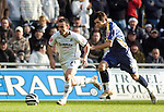Coca-Cola Football League Championship - Swansea City v Cardiff City @ The Liberty Stadium in Swansea..Swansea's Leon Britton is chased by Joe Ledley of Cardiff...
