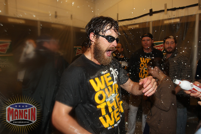 OAKLAND, CA - SEPTEMBER 22:  Josh Reddick #16 of the Oakland Athletics celebrates with beer in the clubhouse after the A's defeated the Minnesota Twins 11-7 to clinch the American League Western Division title at O.co Coliseum on Sunday, September 22, 2013 in Oakland, California. Photo by Brad Mangin