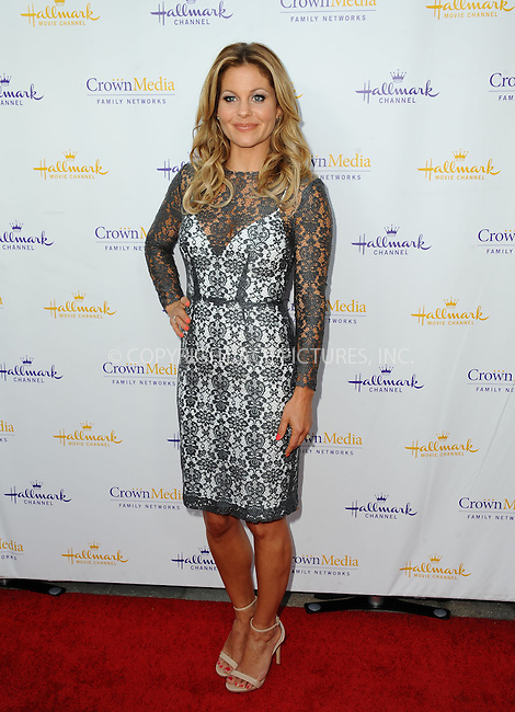 ACEPIXS.COM<br /> <br /> July 8 2014, LA<br /> <br /> Candace Cameron Bure arriving at the Hallmark Channel &amp; Hallmark Movie Channel's 2014 Summer TCA Party on July 8, 2014 in Beverly Hills, California.<br /> <br /> <br /> By Line: Peter West/ACE Pictures<br /> <br /> ACE Pictures, Inc.<br /> www.acepixs.com<br /> Email: info@acepixs.com<br /> Tel: 646 769 0430