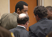 Convicted sniper John Allen Muhammad, left, talks with his defense attorneys Peter Greenspun, center, and Jonathan Shapiro, right prior to being led away after the jury reccommendation of death was read in courtroom 10 at the Virginia Beach Circuit Court in Virginia Beach, Virginia on Monday November 24, 2003. <br /> Credit: Davis Turner - Pool via CNP