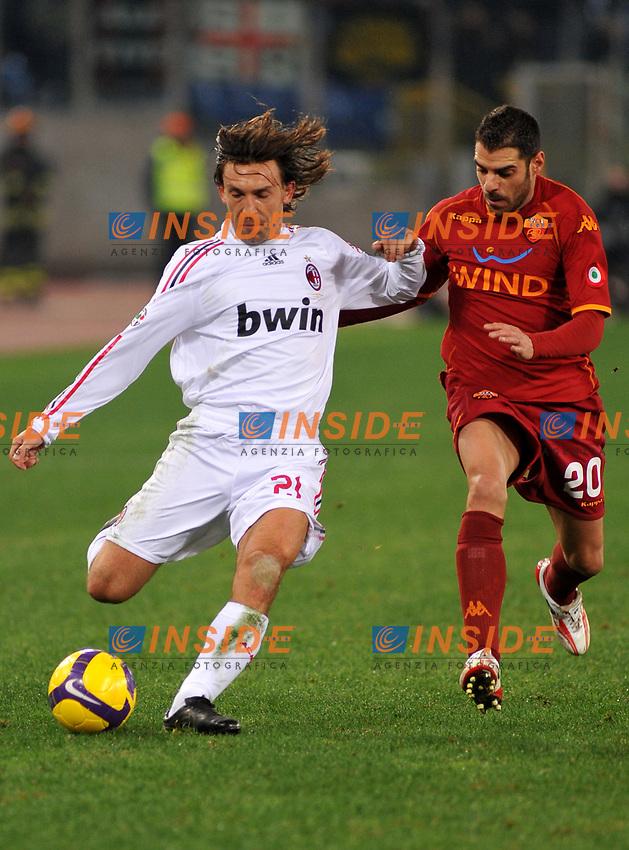 Andrea Pirlo (Milan) e Simone Perrotta (Roma)<br /> Roma 11/1/2009 Stadio &quot;Olimpico&quot; <br /> Campionato Italiano Serie A 2008/2009 <br /> Roma Milan (2-2)<br /> Foto Massimo Oliva/Insidefoto