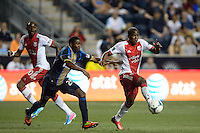Darlington Nagbe (6) of the Portland Timbers is marked by Raymon Gaddis (28) of the Philadelphia Union. The Philadelphia Union and the Portland Timbers played to a 0-0 tie during a Major League Soccer (MLS) match at PPL Park in Chester, PA, on July 20, 2013.