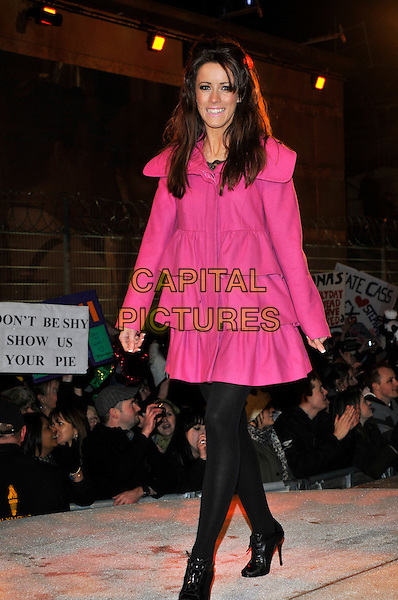 NICOLA T aka NICOLA TAPPENDEN.Leaving The Big Brother House, Celebrity Big Brother Final 2010, Borehamwood, Hertfordshire, UK.29th January 2010.final BB CBB full length pink tiered ruffle coat ruffles black tights lace-up shoes booties shooboots pixie ankle boots .CAP/PL.©Phil Loftus/Capital Pictures.