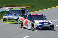 Apr 24, 2009; Talladega, AL, USA; NASCAR Sprint Cup Series driver Dale Earnhardt Jr leads teammate Jimmie Johnson onto pit road during practice for the Aarons 499 at Talladega Superspeedway. Mandatory Credit: Mark J. Rebilas-