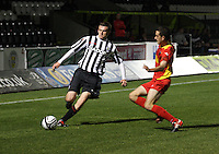 Mark Williams crossing before the challenge from Shaun Byrne in the St Mirren v Dunfermline Athletic Clydesdale Bank Scottish Premier League U20 match played at St Mirren Park, Paisley on 2.10.12..