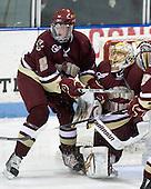 Brian Dumoulin (BC - 2), John Muse (BC - 1) - The Northeastern University Huskies defeated the Boston College Eagles 3-2 on Friday, February 19, 2010, at Matthews Arena in Boston, Massachusetts.