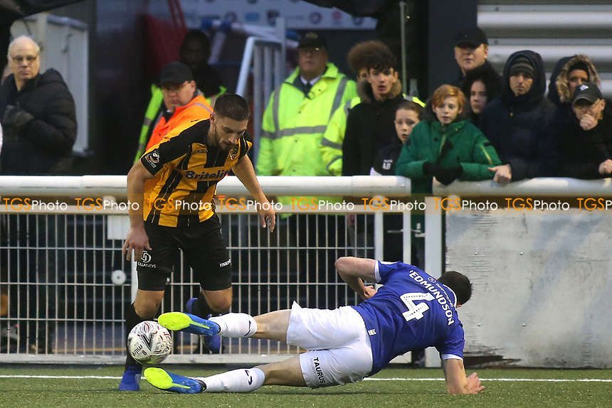 Jake Cassidy of Maidstone United tries to elude a tackle from Oldham's Samuel Edmundson during Maidstone United vs Oldham Athletic, Emirates FA Cup Football at the Gallagher Stadium on 1st December 2018