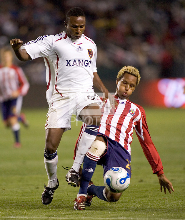 RSL FWD Jeff Cunningham (90) moves past Chivas USA DEF Lawson Vaughn (25) during a MLS game.Chivas USA beat Real Salt Lake 4-0 at the Home Depot Center in Carson, California, Saturday, April 21, 2007.