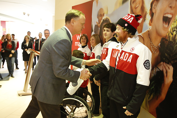 Ottawa, ON - March 28 2014 - Member of Parliament for Ottawa South, David McGuinty, congratulates para-snowboarder John Leslie at the CIBC Paralympic Welcome Home Event at CIBC South Keys Banking Centre in Ottawa (Photo: Patrick Doyle/CIBC)