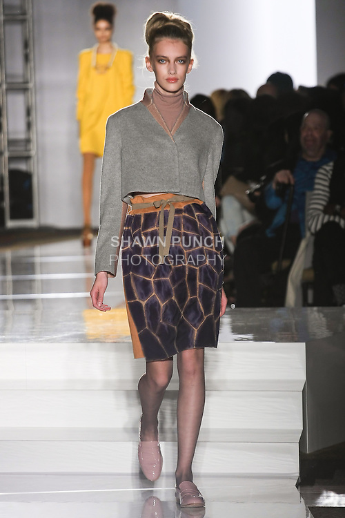 Model walks runway in an outfit by Kathy Sow, for the Parsons 2011 BFA Fashion Show, hosted by Reed Krakoff.