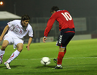 Vardan Bakalyan shoots as he is closed down by Ferid Matri in the Armenia v Switzerland UEFA European Under-19 Championship Qualifying Round match at New Douglas Park, Hamilton on 11.10.12.