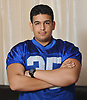 Brian Rodriguez, Copiague High School football player, poses for a portrait inside his family's home on Thursday, Dec. 13, 2018.