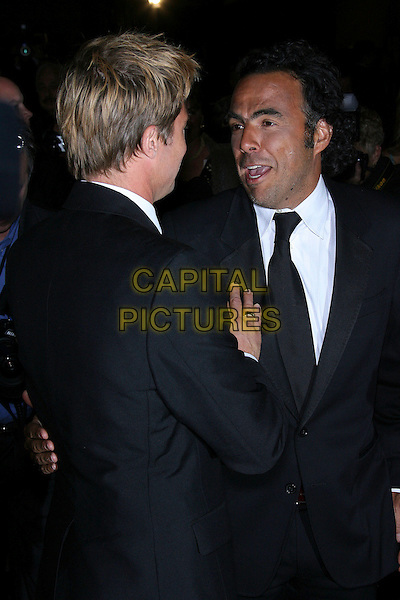 BRAD PITT & ALEJANDRO GONZALEZ INARIRTU .18th Annual Palm Springs International Film Festival Hosts Star-Studded Awards Gala held at the Palm Springs Convention Center, Palm Springs, California, USA,.6 January 2007..half length greeting back behind hand.CAP/ADM/ZL.©Zach Lipp/Admedia/Capital Pictures