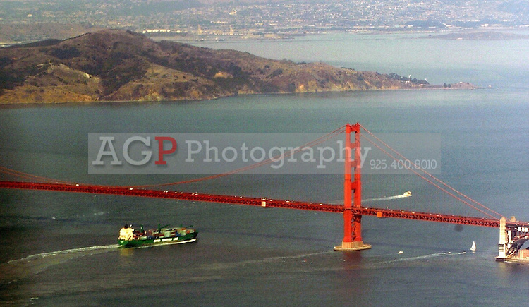 Oct 13, 2004 - Over Northern California, CA, USA - Coast Guard Auxiliary Pilots and observers have an excellent view of ship and boat movements from their Cessna 340 piloted by Jerry Kurota of Pleasanton during a mission over the Northern California coast Wednesday Oct 13, 2004. Ships are seen moving under the Golden Gate Bridge. The Livermore based crew with ramp up their flights over coastal waters as the November elections near..(photo by Alan Greth)