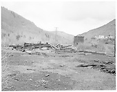 Looking north at the remains of the Rico roundhouse with tank to right.<br /> RGS  Rico, CO  Taken by Payne, Andy M. - 5/20/1967